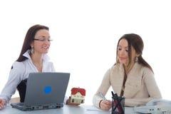 Business women advertises real estate on white royalty free stock photo