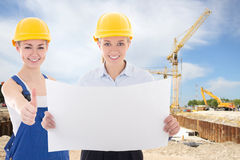 Business women architect and builder in yellow helmet Royalty Free Stock Photography