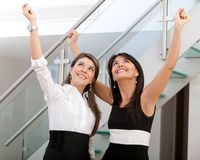 Business women with arms up Stock Photo