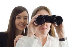 Business women with binoculars Royalty Free Stock Image