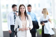 Portrait of successful business woman on blurred background office Stock Image
