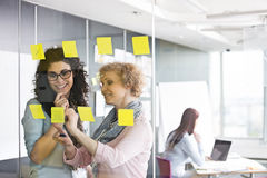 Business women brainstorming with sticky notes in office royalty free stock photos