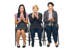 Business women on chair clapping Royalty Free Stock Images