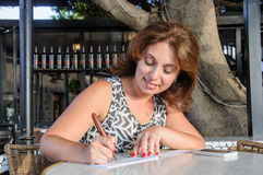 Business women Check in Checkbook Royalty Free Stock Photo