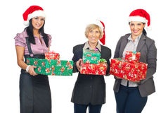 Business women with Christmas gifts royalty free stock photography