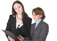 Business women comparing notes Royalty Free Stock Photos