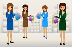 Business women with credit cards and purchases in hands Royalty Free Stock Photos