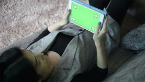 Business women and digital tablet with green screen, lay down on sofa for working in the Office, full HD stock video
