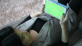 Business women and digital tablet with green screen, lay down on sofa for working in the Office, full HD stock footage