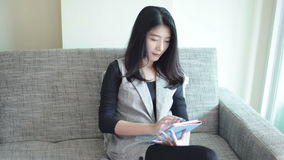 Business women and digital tablet, sitting on sofa for working in the Office, full HD stock video