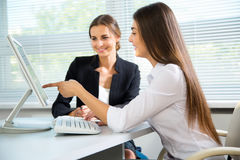 Business women discussing in a meeting Stock Image