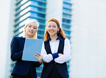 Business women discussing new project outside corporate office royalty free stock photos