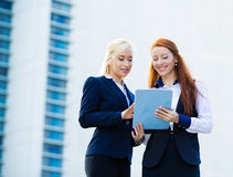 Business women discussing, planning future meeting royalty free stock image