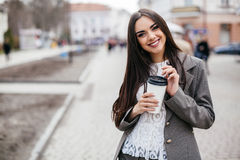 Business women drinking coffee on a street Royalty Free Stock Photos