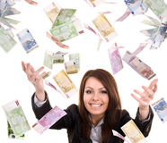 Business women with flying money. Isolated royalty free stock image