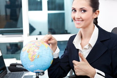 Business women found  place for new job. Smiling and giving  thumb up Royalty Free Stock Photos