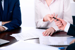 Business women giving a pen to business man for contract signing Stock Photography