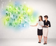 Business women with glowing letter concept Royalty Free Stock Photography