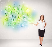 Business women with glowing letter concept Stock Photos