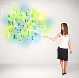 Business women with glowing letter concept Stock Images