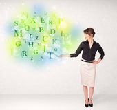 Business women with glowing letter concept Royalty Free Stock Photo