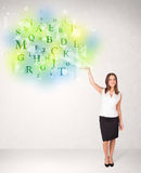 Business women with glowing letter concept Royalty Free Stock Images