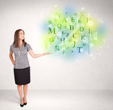 Business women with glowing letter concept Royalty Free Stock Image