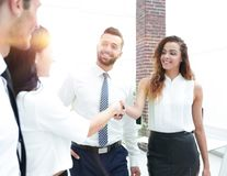 Business women greet each other with a handshake. Before the start of the presentation Royalty Free Stock Photos