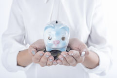 Business women hand holding coin and piggy bank. concept saving. Finance and investment Royalty Free Stock Image
