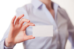 Business women handing a business card Royalty Free Stock Photo