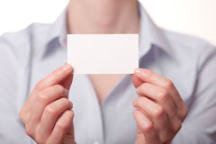 Business women handing a business card Stock Photos