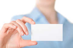 Business women handing a business card Royalty Free Stock Image