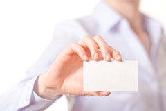 Business women handing a business card Royalty Free Stock Photography