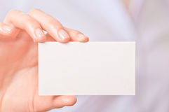 Business women handing a business card Royalty Free Stock Images