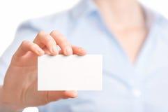 Business women handing a business card Royalty Free Stock Photos