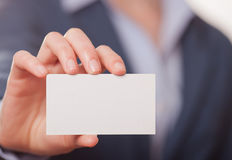 Business women handing a business card Stock Photo