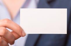 Business women handing a business card Stock Photos
