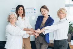 Business women hands together teamwork diversity. Business women hands together. Equality unity. Cooperation collaboration teamwork. Diversity strength success stock images