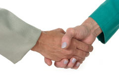 Business Women Handshake 2. Closeup of two business women shaking hands. Shot on white stock photos