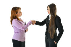 Business Women Handshake. Two business women shake hands on a deal Royalty Free Stock Photo