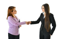 Business Women Handshake. Two business women shake hands on a deal Royalty Free Stock Images