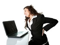 Business women having back pain. Royalty Free Stock Photo