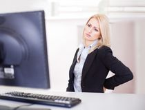 Business women having back pain Stock Photo
