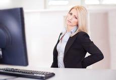 Business women having back pain royalty free stock photos