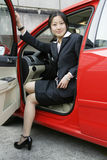 Business women with her car. Business women with her red car Royalty Free Stock Images
