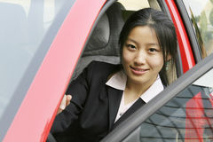 Business woman with her car. Business woman with her red car Stock Photography
