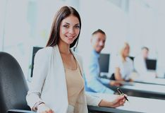 Business woman with her staff, people group in background. Stock Images