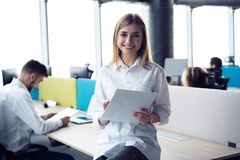 Business woman with her staff, people group in background at modern bright office indoors. royalty free stock image