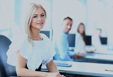 Business woman with her team at the office. Business women with her team at the office Royalty Free Stock Images