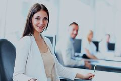Business woman with her team at the office. Business women with her team at the office Royalty Free Stock Photos